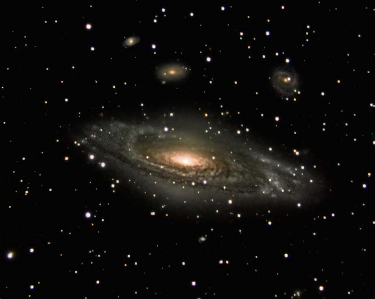NGC7331: Spiral galaxy NGC 7331 is often touted as an analog to our own Milky Way. About 50 million light-years distant in the northern constellation Pegasus, NGC 7331 was recognized early on as a spiral nebula and is actually one of the brighter galaxies not included in Charles Messier's famous 18th century catalog. Since the galaxy's disk is inclined to our line-of-sight, long telescopic exposures often result in an image that evokes a strong sense of depth. The effect is further enhanced in this well-framed view by the galaxies that lie beyond this beautiful island universe. The background galaxies are about one tenth the apparent size of NGC 7331 and so lie roughly ten times farther away. The visual grouping of galaxies is also known as the Deer Lick Group. This image is a personal favorite of mine.