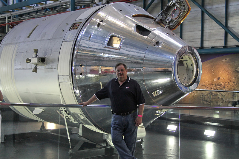 My brother Dean in front of th service module in the Saturn V museum.