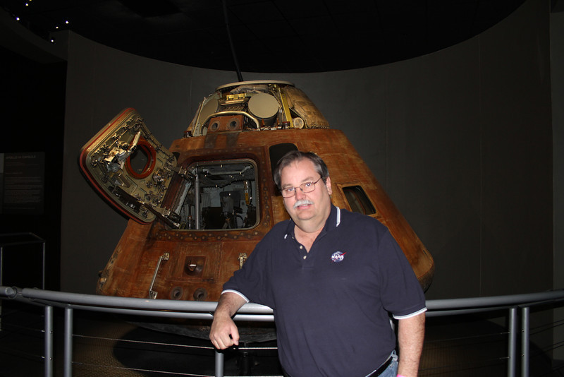 My brother Dean in front of the Apollo 14 command module.