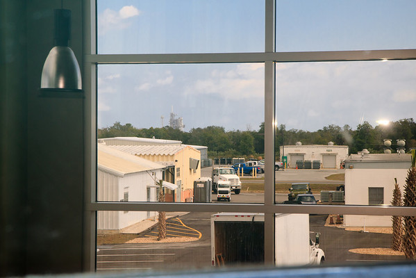 This is the view of the shuttle launch pad through the old Launch Control Windows. You can still see the salt air and nicotine stains glazing the windows from back in the day when NASA allowed smoking in the control center.