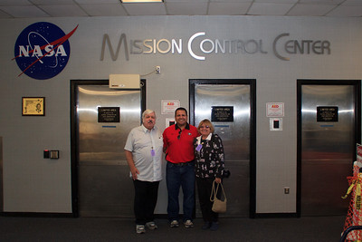 Here's Dad, Mom and me in front of the doors that are the entrance to the Mission Control Center
