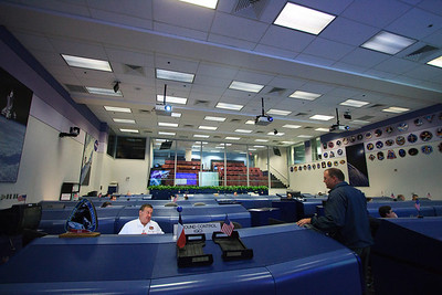 """This is Bill Foster in the """"White Flight Control Room"""". He has been the Ground Control for the Shuttle as well as the ISS. He's also created many NASA program and commemorative patches, including the Spaceflight Memorial Patch, seen here: http://spaceplex.com/2011/01/27/remembering-apollo-1-challenger-and-columbia/ Bill is the one that told us the story about the flag on the moon in the Missions Operations Control Room."""