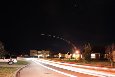 January 17, 2009...From my front yard...this is the launch of a Delta IV Heavy rocket at Cape Canaveral, taking a top secret military satellite into orbit for the National Reconnaissance Office.  The lights in the road are my truck...I thought I'd add a little action to the foreground as well.
