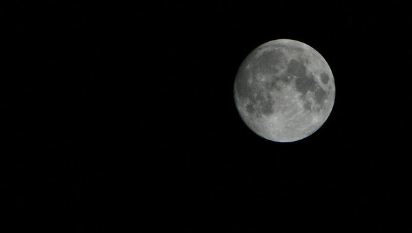 Midnight, morning of 02/20/2008.  Practicing with my new lens for tonite's Total Lunar Eclipse.  I know, I'm such a geek.