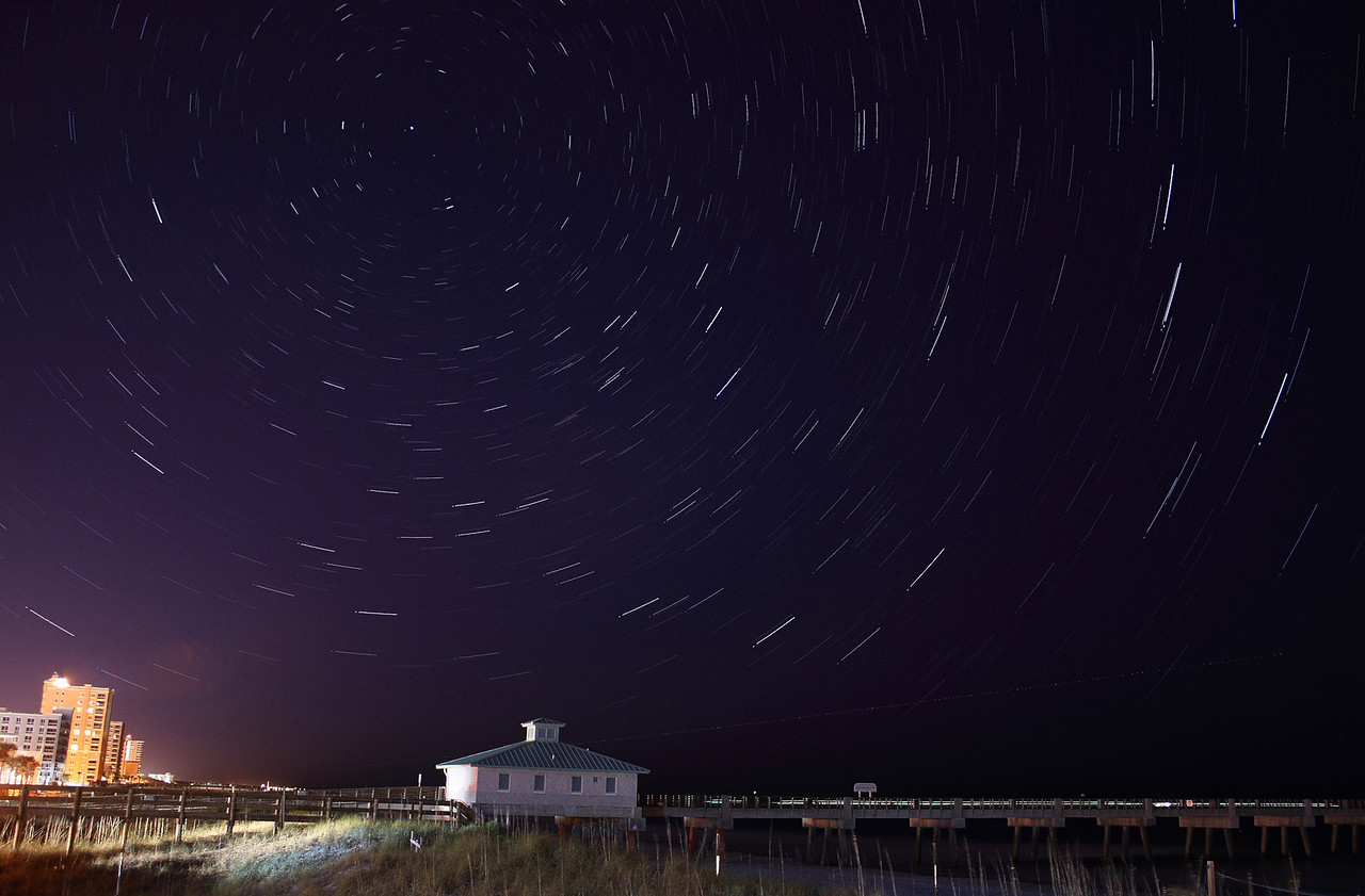"""Star Trails at Jax Beach on 2/1/2009.  This is 18 minutes worth of exposures.  That's all I could do before I got bored (and cold!)  If you are interested in photographing star trails yourself, check out our latest article, <a href=""""http://www.jamesvernacotola.com/Resources/How-To-Photograph-Star-Trails/12233655_6n3up"""">How to Photograph Star Trails</a>!"""