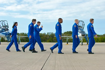 02/20/2011 -- Cape Canaveral, Florida -- Space shuttle Discovery's STS-133 crew leaves the Kennedy Space Center Shuttle Landing Facility after addressing the news media on Sunday afternoon. From left to right are Mission Specialists Nicole P. Stott, Michael R. Barratt, Stephen G. Bowen, and Alvin Drew, Pilot Eric A. Boe, and Commander Steven W. Lindsey.