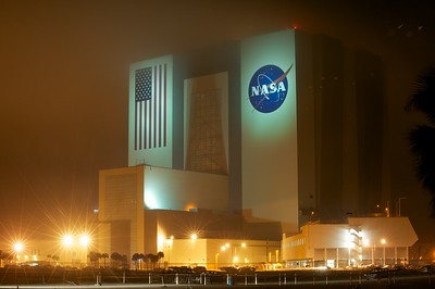 02/23/2011 -- Cape Canaveral, Florida -- The Vehicle Assembly Building glows in the fog, lit by the surrounding sodium vapor lights on the eve of space shuttle Discovery's final launch.