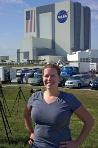 02/24/2011 -- Cape Canaveral, Florida -- Enthusiastic photographer Lindsay Wiles Gramana poses in front of the Vehicle Assembly Building at Kennedy Space Center about 90 minutes prior to space shuttle Discovery's STS-133 launch.
