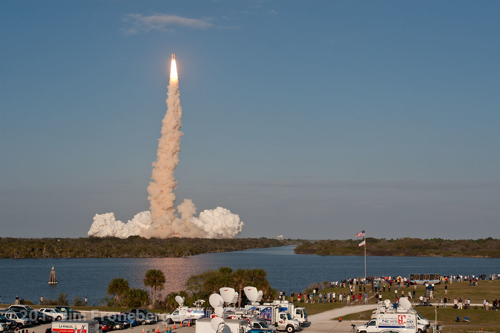 The launch of Discovery on  STS-133 as seen from the top of the CBS Building at the Kennedy Space Center press site. Wide angle.