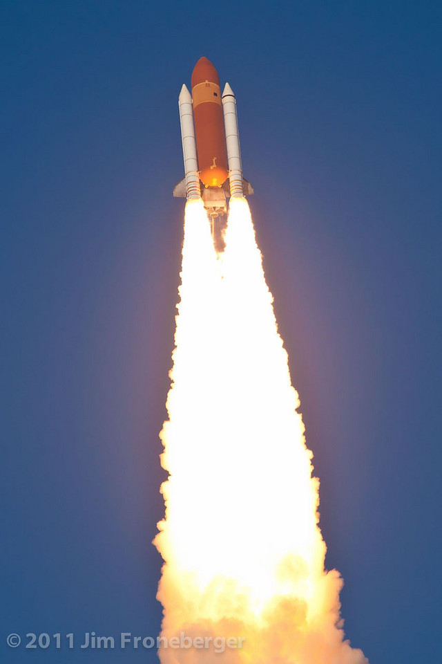 The launch of Discovery on  STS-133 as seen from the top of the CBS Building at the Kennedy Space Center press site. Zoom lens and cropped.