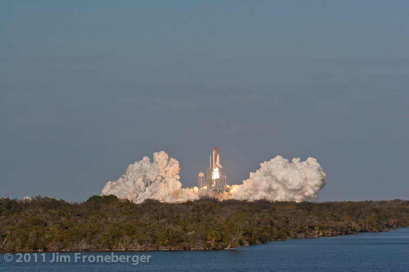 The launch of Discovery on  STS-133 as seen from the top of the CBS Building at the Kennedy Space Center press site.