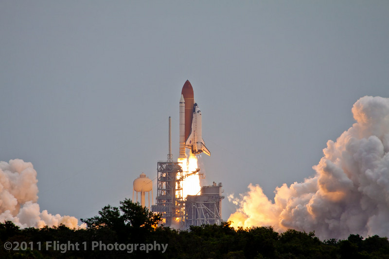The launch of Atlantis on  STS-135 as seen from the Kennedy Space Center press site