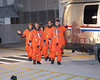 "The STS 131 crew walking out to board the famous ""Airstream"" van on thier way to board the shuttle Discovery for launch on 4/5/2010"
