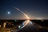 "<font face=""arial"" size=2> <font size=4>02/08/2010 at 4:14 am - ""Waterway to Orbit""</font> - Space Shuttle Endeavour STS-130 launches into orbit toward the east, as the stars and waning crescent moon trail toward the west, leaving a beautiful reflection on the Intracoastal Waterway in Ponte Vedra, Florida. This 132-second time exposure of the final night launch of a Space Shuttle, from launch through SRB separation, was taken 115 miles north of Launch Pad 39A at Kennedy Space Center.<br><br>  The response to this photo has been absolutely amazing, so I've given it it's own gallery.  The photo has generally become known as ""Waterway to Orbit"", thanks to Jerry Bonnell of the <a href=""http://apod.nasa.gov/apod/image/1002/launch_vernacotola_s.jpg"" target=""_blank"">NASA Astronomy Picture of the Day</a>.<br><br>  I wanted to use this space to answer a few questions that have been emailed to me and that I have seen on the web.  (I admit it, I googled myself :D ).  If you have further questions or comments, or if you would like to be added to my mailing list, please feel free to <a href=""javascript:norobotmail('jamesvernacotola', 'gmail.com')""> <span class=""myEmail"">email me</span></a> or leave a comment on this page.<br><br>  <font size=4>What type of camera did you use and what were your settings for this picture?</font><br> I used a <a href=""http://www.amazon.com/gp/product/B001XURPQS?ie=UTF8&tag=wwwjamesverna-20&linkCode=as2&camp=1789&creative=9325&creativeASIN=B001XURPQS"" target=""_blank"">Canon EOS Rebel T1i </a><img src=""http://www.assoc-amazon.com/e/ir?t=wwwjamesverna-20&l=as2&o=1&a=B001XURPQS"" width=""1"" height=""1"" border=""0"" alt="""" style=""border:none !important; margin:0px !important;"" />, with a <a href=""http://www.amazon.com/gp/product/B000EW8074?ie=UTF8&tag=wwwjamesverna-20&linkCode=as2&camp=1789&creative=9325&creativeASIN=B000EW8074"" target=""_blank"">Canon EF-S 17-55mm f/2.8 IS USM Lens </a><img src=""http://www.assoc-amazon.com/e/ir?t=wwwjamesverna-20&l=as2&o=1&a=B000EW8074"" width=""1"" height=""1"" border=""0"" alt="""" style=""border:none !important; margin:0px !important;"" />  attached; no filters. I was pretty sure I had it set to 17mm but exif shows 18mm.  Maybe it creeped a bit while I was rushing to decide the exposure and composition.  Exposure was ISO 100, f/4, and 132 seconds.<br><br>  <font size=4><b>Please let me know when I can purchase a copy. Hope it is soon.</b></font><br> The photo is finally available for purchase!  Click the ""Buy"" button at the top of this page to purchase a copy.  I priced them reasonably so as not to exclude anyone who is interested in purchasing.  Thanks so much for all of your interest and patience.  I am truly humbled.<br><br>  <font size=4><b>Are you interested in licensing it for commercial projects?</b></font><br> Absolutely.  Please <a href=""javascript:norobotmail('jamesvernacotola', 'gmail.com')""> <span class=""myEmail"">contact me</span></a> if you are interested.<br><br>  <font size=4><b>Have you altered the photo in any way?  Also how much post-production editing did you do to adjust the colors, etc.</b></font><br> I did not alter the content of the image at all.  Really the only thing I did was some slight adjustments to white balance, exposure, clarity, vibrance and contrast in Adobe Lightroom.<br><br>  <font size=4><b>Incredible shot. How much of that was pure luck or great planning? </b></font><br> I have always heard that in photography, the more planning you do, the more you get lucky.  I had photographed 2 shuttle launches and 2 rocket launches from the Jacksonville/Ponte Vedra area before shooting this one, and one from the same bridge, so there were a few things I knew to expect.  I also had a general idea of where to stand on the bridge to see the shuttle rise from the vanishing point of the Intracoastal Waterway.  The luck came into play with the fact that is was such a clear night and because I overslept and only had 7 minutes to prepare when I got there. :) <br><br>   <font size=4><b>I noticed a strange pinkish smudge on the APOD image that seems to have about the same smear direction as the stars, but not as long. Can you say what that thing is below the two fainter stars in this clip from your photo? I suppose it might be Mars? But then why the difference in length?</b></font><br> After looking closely at the pinkish smudge, I've determined that it is some light flare, reflecting from the moon.  Check out the photo below for a higher-res photo of the moon (darkened for clarity) and the flare, side by side.  You can see they have the exact shape.  I considered removing it from the photo but ultimately decided to leave it since I had done nothing else to alter the photo.<br><br>  <img src=""http://jimmyv99.smugmug.com/photos/886037535_LZQnU-O.jpg""><br><br>  <font size=4><b>Interesting that the stars ""moved"" a little due to the open shutter/time lapse method, but why would the MOON not do the same thing???  Why is the rocket's actual path heading NE....100's of miles NE toward Spain which was the actual path for emergency ditching/landing...and the reflection kept going straight north up the ICW.....toward the Palm Valley Bridge it appears..???? The reflection should be UNDER the path of the rocket eventually, and therefore, would it not be out over the ocean?? Beautiful anyway, but I am less convinced that it is real.....???</b></font><br> As far as the question about the reflection is concerned,  my original answer was ""I don't know"", however Michael Scott (of Johnson Space Center, not Dunder Mifflin :) ) has emailed me with the best answer I've heard so far. Here it is:<br> ""I think it's due primarily to two things – that the Shuttle is climbing to extremely high altitude and that you are so far from it.  If this were an airliner flying the same direction as the Shuttle (43 degree constant azimuth), at the same distance from you, it would be very low on the horizon, mostly not visible in the waterway, and its flight would appear linear and not an arc like the Shuttle.  People often compare how the Shuttle flies to more familiar vehicles like airplanes, but they are very different in many ways.""<br><br>  I've been receiving many questions similar to the one about the moon, either asking why the moon did not move in the same way the stars did, or why the photo shows a full moon when the last full moon was January 30.  Check out the photo above to see the moon at full res, exactly as it is in the photo, and then darkened for clarity right next to it.  As you can see, the moon was actually in the waning crescent moon phase and it ""moved"" as much as the stars did.  It's just a coincidence that it looks full in the lower res version of this photo at the top of this page.<br><br>  <font size=4><b>I'll find the picture again with Google, somehow track down the guy who took the photo, and let him know his camera sucks.</b></font><br> I just had to post this one because it entertained me. :) I'm pretty sure it had to do with the 1000x761 resolution available.  I used a Canon EOS Rebel T1i to shoot the photo.  It's far from a pro level camera but plenty capable of producing great images.  <br><br>  <font size=4><b>Is it ok if I post the photo on my blog or in a user forum?</b></font><br> You can post on your blog or a forum as long as you don't profit from my photo.  You can click <a href=""http://apod.nasa.gov/apod/image/1002/launch_vernacotola_s.jpg"" target=""_blank"">here</a> for the highest resolution photo available, which is on NASA's Astronomy Picture of the day.  I only ask that you credit me for the photo and link back to this website. Thanks.<br><br>  <font size=4><b>Congratulations on a beautifully composed shot. Technically excellent. Only question in my mind is ""elevation"", this does not appear to have ben taken off the bridge at road height. I'm intrigued.</b></font><br> The Intracoastal Waterway Bridge in Ponte Vedra is higher than you might imagine for being in a predominantly residential area.  You can see a photo of it <a href=""http://upload.wikimedia.org/wikipedia/commons/b/b9/New_Palm_Valley_Bridge.jpg"" target=""_blank"">here</a>.<br><br>  <font size=4><b>I'm interested in a wallpaper version of your nighttime exposure of the Endeavor launch. I could use the one on your site, but I'd like to know if I could get a higher resolution copy of it, so it'll look great blown up. Let me know if that's possible.</b></font><br> At this point, the largest resolution available is at the <a href=""http://apod.nasa.gov/apod/ap100213.html"" target=""_blank"">Astronomy Picture of the Day</a> website.  If that changes I'll be sure to update you here.  If you would like to be added to my mailing list, click <a href=""javascript:norobotmail('jamesvernacotola', 'gmail.com')""> <span class=""myEmail"">here</span></a> to email me.<br><br>  <font size=4><b>Loved your photos of star trails. Can you tell me how that is done?</b></font><br> Since there has been some interest in some of my astronomy photos, I plan to create a ""how to"" for my star trails photos.  It might be a week or so before I can get to that.  Please check back for updates.<br> <b>EDIT (05/21/2010):</b> It took a lot longer than I thought it would to put this together, but I've finally finished <a href=""http://www.jamesvernacotola.com/Resources/How-To-Photograph-Star-Trails/12233655_6n3up"">How to Photograph Star Trails</a>!  Please give it a read (and then give it a try :) ) and let me know what you think.<br><br><br>  <font size=4><b>Do you post your pics on Flikr or someplace else?</b></font><br> Currently, this site is the only place I post my photos.<br> <b>EDIT (04/02/2010):</b> I've recently started a Flickr photostream.  Check it out <a href=""http://www.flickr.com/photos/26216961@N07/"" target=""_blank"">here</a>.<br><br>  <font size=4><b>Are you available for hire?</b></font><br> If you are in the Jacksonville/St. Augustine area and are interested, please <a href=""javascript:norobotmail('jamesvernacotola', 'gmail.com')""> <span class=""myEmail"">contact me</span></a>.<br><br>  Thanks again for all of your nice comments.  If you have further questions, please don't hesitate to contact me.<br><br>  Jimmy"