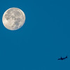 Near Full Moon with Plane Crossing