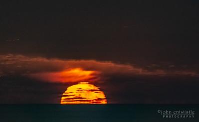 TImelapse Video of Near-Full Moon Rising Over Ocean Horizon 12/23/18