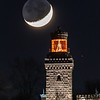 The Crescent Moon With Earthshine Setting Behind The Christmas Decorated Twin Lights Lighthouse 12/18/20