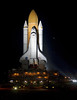 Atlantis bathed in zenon lights inches closer to the pad.