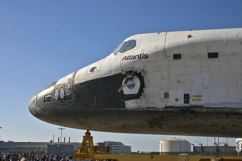 Atlantis moves past as hundreds watch this historic move.
