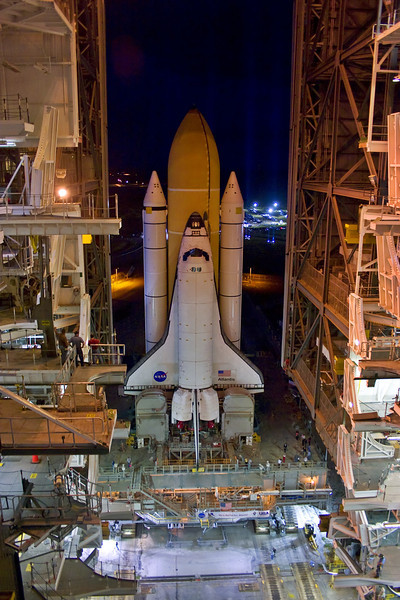 Atlantis reaches the doors of the VAB for the last time.  First motion was delayed about 35 minutes due to a hydraulic leak on the crawler-transporter.