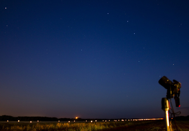 Looking to the North the Big Dipper can be seen over the runway at dawn, just before Discovery takes off for DC.