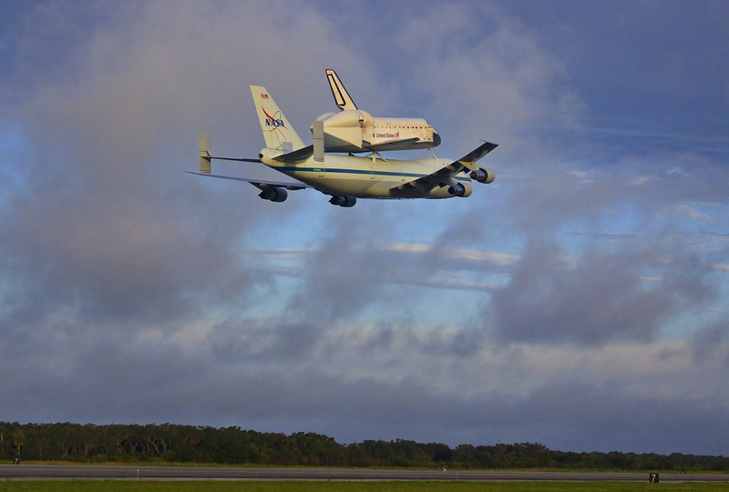 The Shuttle Carrier Aircraft with Endeavour leave KSC for California. This is the last time that a 747 will ferry a Space Shuttle Orbiter