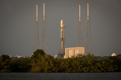 A SpaceX Falcon 9 V1.1 rocket sits on the pad ahead of Thursday's Thanksgiving Day launch attempt from Launch Complex 40 at Cape Canaveral Air Force Station. The first attempt was halted after computers showed that the engines had a slower than expected thrust rate upon startup. The launch would later be scrubbed so that engineers could inspect the engines before another attempt can be made on a date still to be determined. The Falcon 9 will be launching the SES-8 broadcasting satellite, which will provide television coverage to South Asia and China. This will be the first commercial satellite launch from the United States since 2009 and the furthest reaching mission to date by SpaceX.