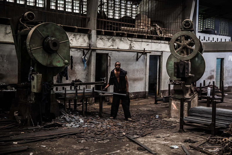 Workers cut steel to make leaf springs in Nairobi.