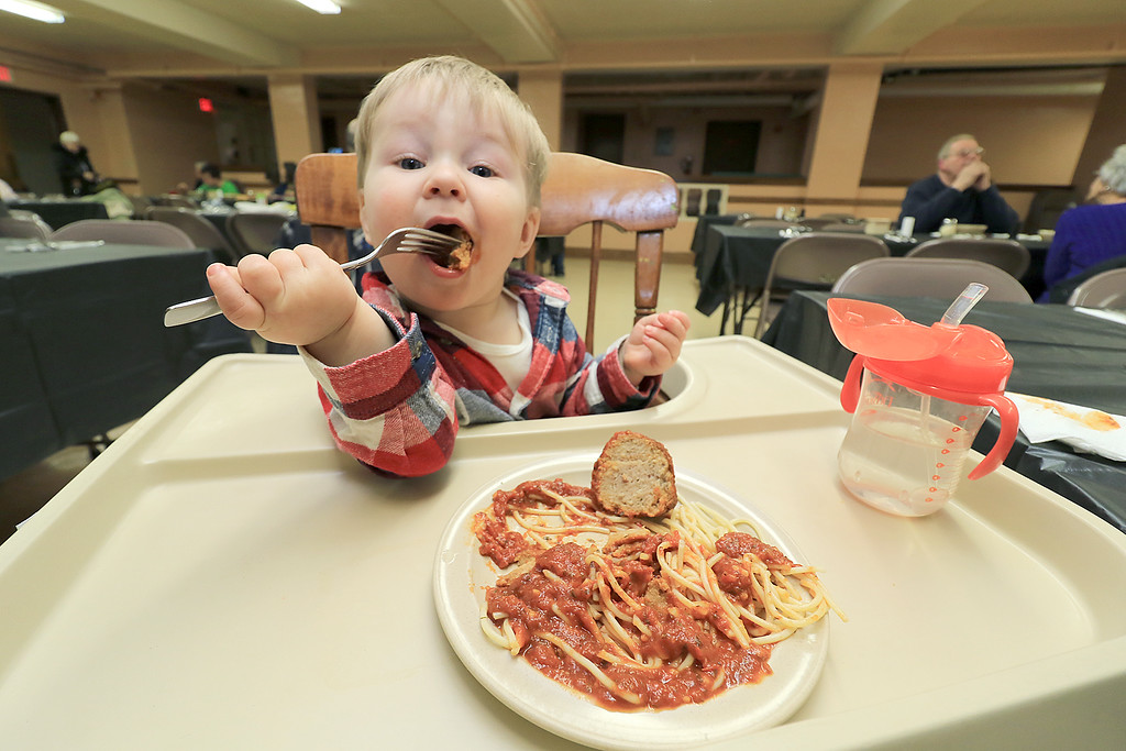 . Rollstone Congregational Church in Fitchburg holds a a spaghetti dinner on the second Wednesday of every month as a fundraiser for the church. It is put on by the kitchen committee from the church. Andrew Jolly, 1, enjoys his spaghetti dinner. SENTINEL & ENTERPRISE/JOHN LOVE