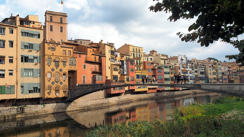 Gorgeous colorful architecture and reflections in the water during our Girona walking tour