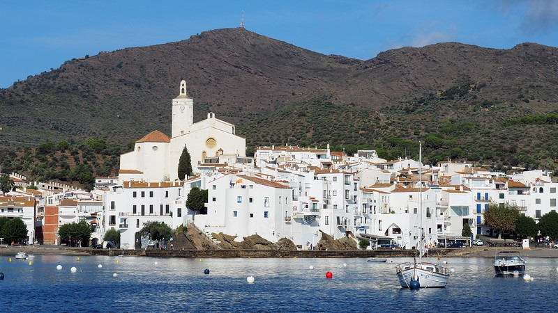 Views of the gorgeous white architecture of Cadaqués from our sailboat in Costa Brava, Catalan, Spain