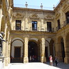 "Seville is a university town.  This building, now part of the university, was originally a ""tobacco factory""."