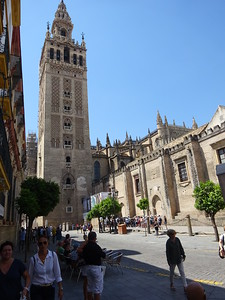 Seville was part of the Moorish empire until the Reconquista.  Sometimes mosques were simply converted to Christian churches.
