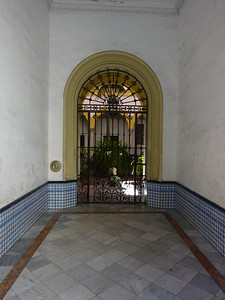 It gets hot here in the summer.  Many of the older buildings have shaded, interior courtyards.