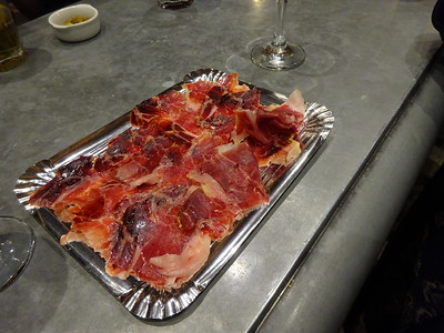 Jamon Iberico, from pigs fed 100% acorns.  The hams are cured for 2 to 3 years, then sliced paper thin.