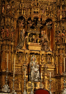 The main altar art in Seville Cathedral, Spain has 45 separate scenes carved out of wood and covered in  huge amounts of real gold.