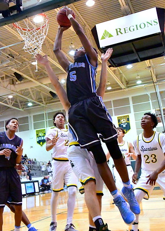 Action from a game between Spain Park and Mountain Brook on Tuesday, January 17, 2017, at Mountain Brook High School in Mountain Brook, Alabama.