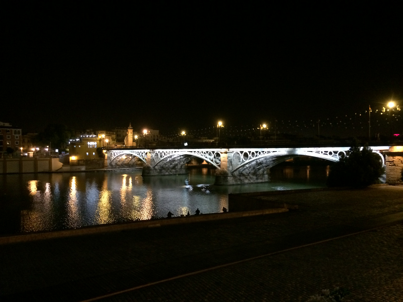 The Triana bridge was built in the mid 1800's similarly designed as the Pont Neuf bridge in Paris, France. It connects Seville to Triana district across the Guadalquivir river.