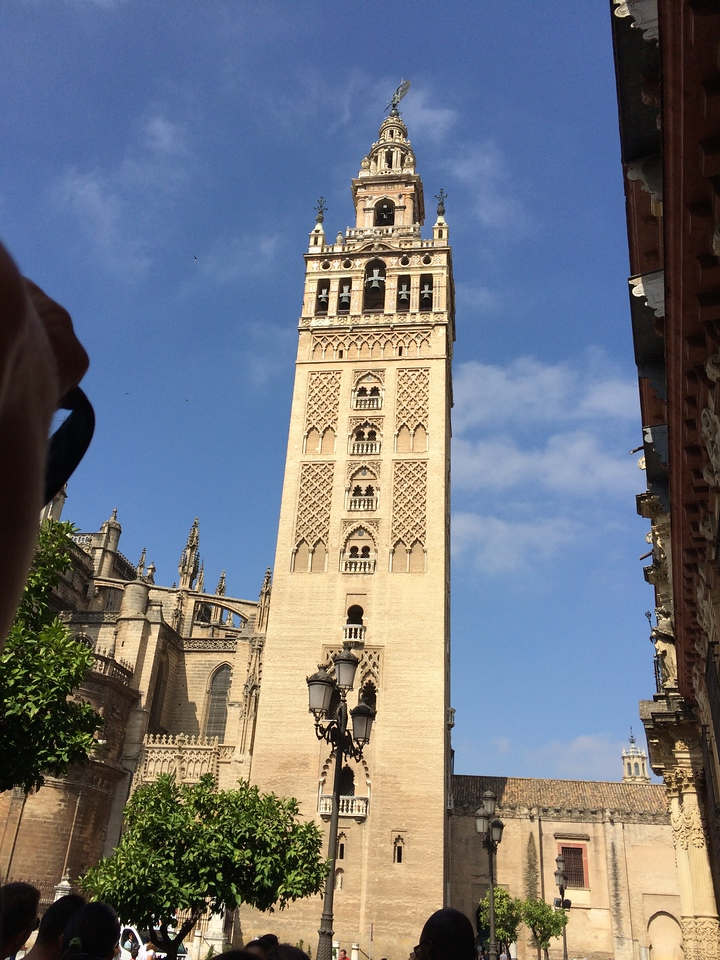 The Giralda tower of the cathedral, formerly a minaret and an important structure during the medieval period of Seville, was converted into a bell tower by adding the top most section where the church bells are. Many tower structures today have been inspired by the Giralda tower, for example, the clock tower of the SF Ferry Building or one in NYC Madison Square Garden.