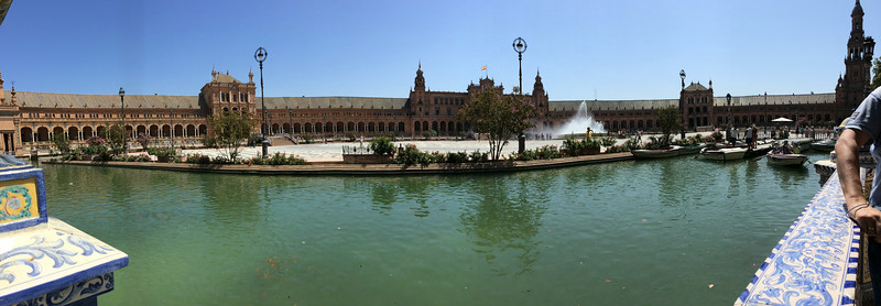 A panoramic view of Plaza  de Espana of Seville. Built for the Iberico-American Exposition of 1929 in Maria Luisa Park. A mixture of art deco and mudejar style. A movie magnet, parts of Star Wars, The Dictator, even one episode of Amazing Race was filmed here.