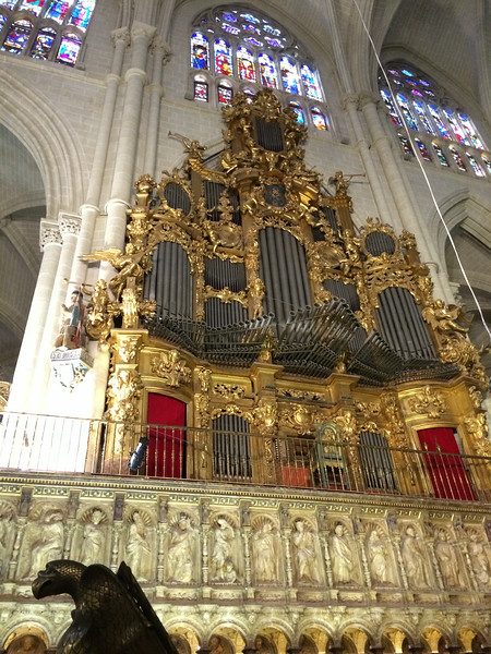 If you look above the left side of the choir stall is the baroque style organ.