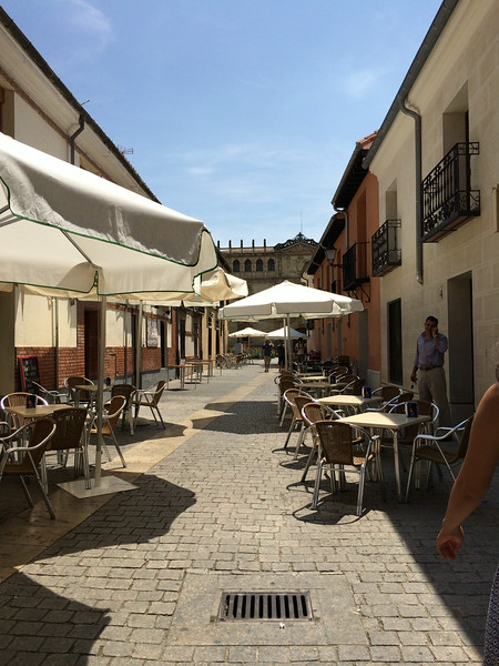 Street leading to Alcala de Henares University...<br /> Alcala with its cobblestoned streets is a UNESCO World heritage site and is the birthplace of Miguel de Cervantes, author of Don Quixote.