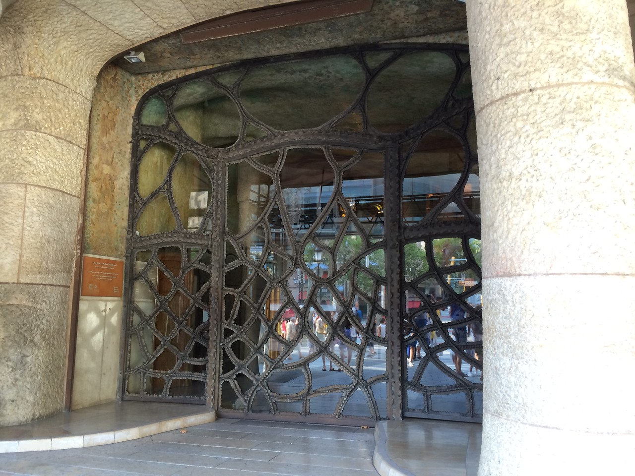 Then off we went to Passeig de Gràcia to see another Gaudí work, Casa Mila.<br /> Passeig is Catalan for promenade. The whole building was covered in construction tarp and all I could get was the door. Again curvilinear lines and iron work typical of Gaudí.