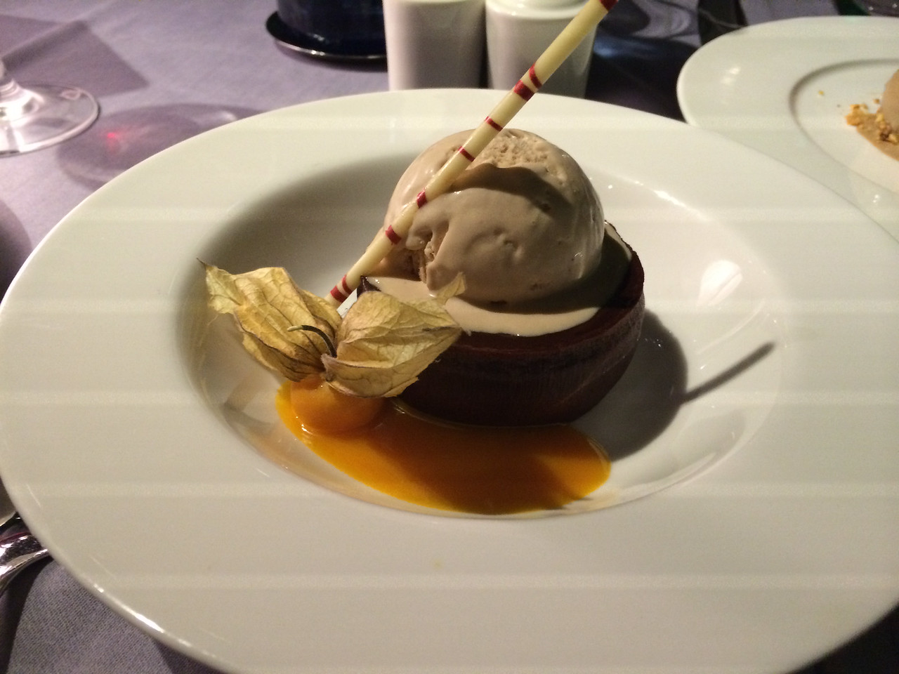Yum. Dessert of chocolate cake and ice cream with mango sauce... Yum!