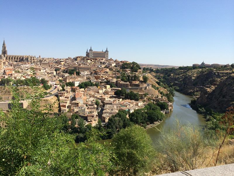 Toledo is flanked on 3 sides by the Tagus River. The city is another of Spains many UNESCO World Heritage site. It has over 2000 years of history with lots of different influences from the Romans to the Visigoth to the Muslims to the Jews and then the Christians. Known as a city of three cultures because in the past Christians, Jews, and Muslims lived together for centuries. You will see synagogues, churches, and mosques.
