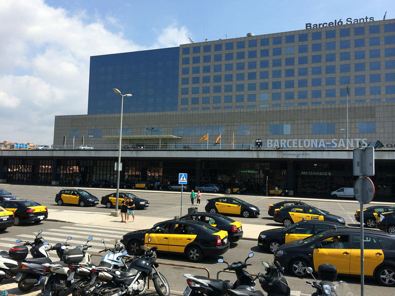 The taxis stands at the Barcelo Sants train station. Barcelona has black and yellow, the Madrid taxis are white with red stripe and the Seville taxi's are  white with yellow stripe...and yes, they have Mc Donalds everywhere...
