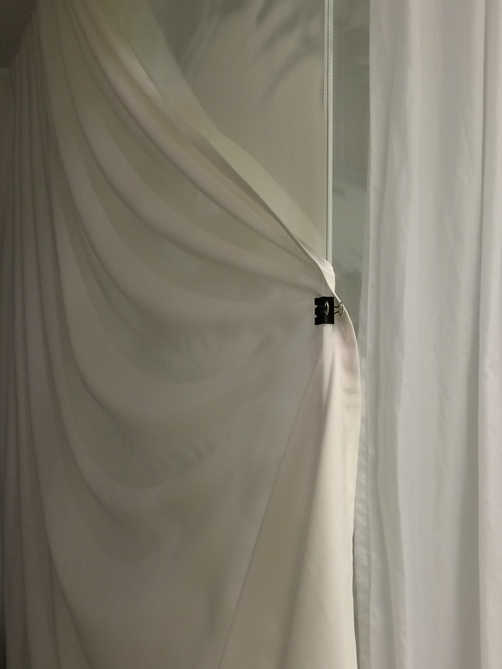 Had to use a paper clip for shower privacy since the curtains don't go all the way around the shower...thank goodness I brought it:-)