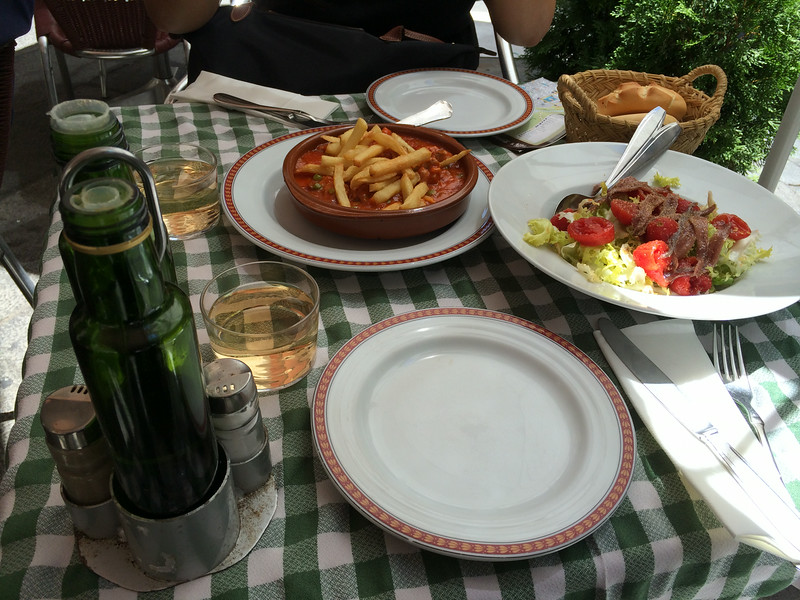 We asked for dishes typical of Toledo so we ordered a stew(the one with fries on top) and salad with anchovies. All yummy and bread dipped in the wonderful olive oil of Spain so delicious. Topped off with Vino Blanco.