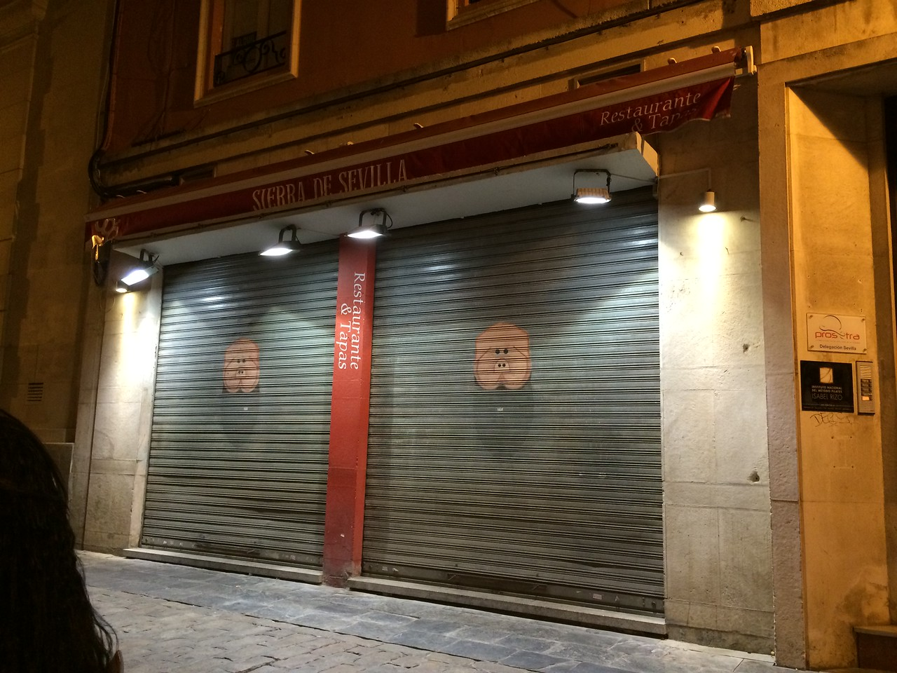 The rolling shutters for this restaurant is pulled down at closing at around midnight to 1am. Buenas noches or is it buenas dias?!