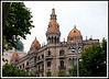"Barcelona - View from Placa de Catalunya down Passeig de Gracia, one of the main shopping avenues in Barcelona. The building is an example of the ""Modernisme"" or Catalan Art Nouveau and was the way of life as Barcelona burst into the 20th century."